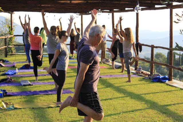 Outdoor Yoga Platform overlooking vineyards and olive groves at Il Borghino. Yoga Retreat Italy