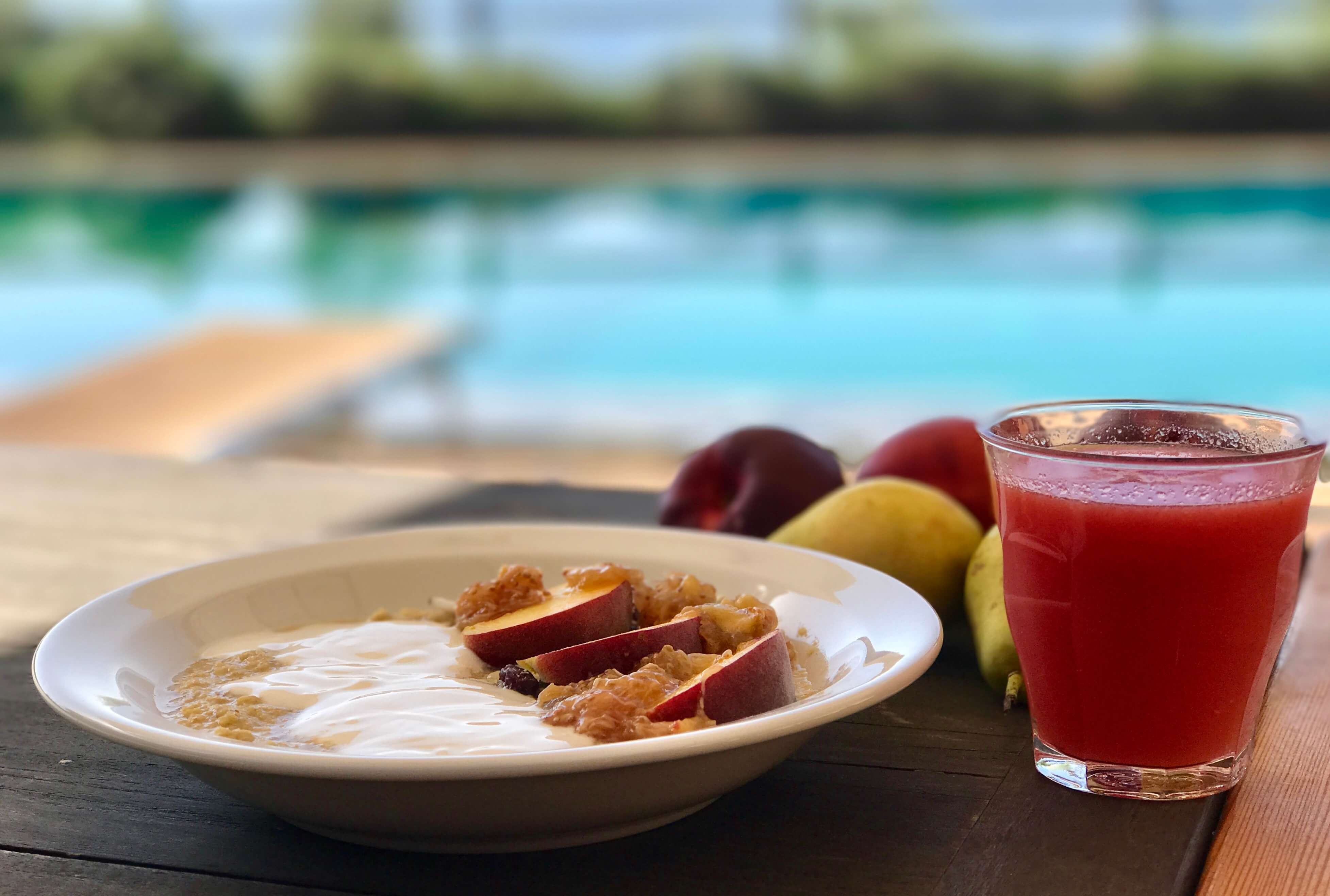 Yoga in Italy delicious breakfast with Amaranth porridge, sliced sun-ripened nectarines and fresh yogurt together with a freshly squeezed juice