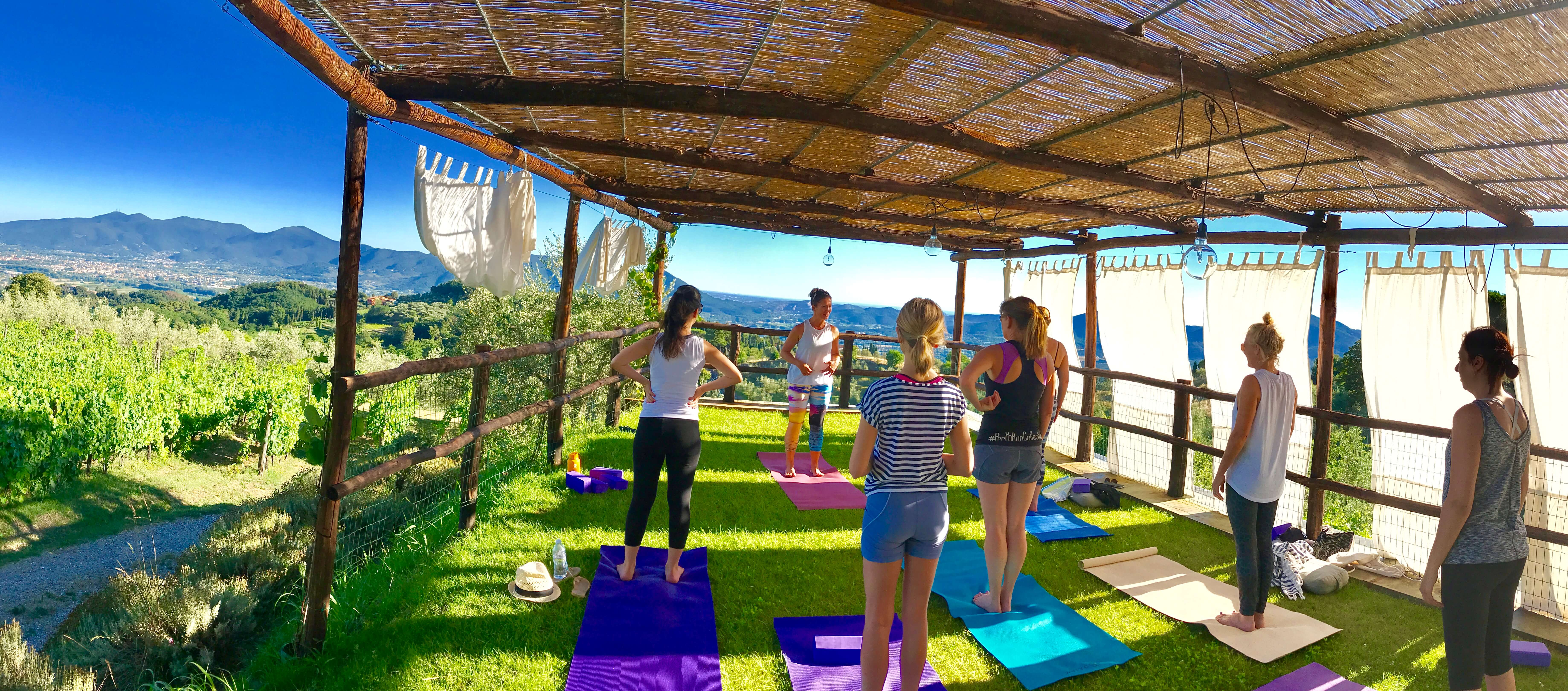 Yoga in Italy - practicing afternoon yoga up at outdoor yoga platform.
